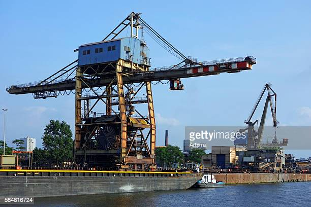 Dock cranes at the steelworks of ArcelorMittal world's largest steel producer port of Ghent East Flanders Belgium