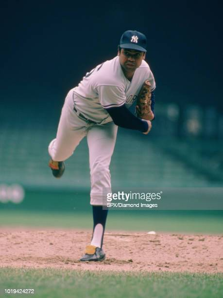 Dock Ellis of the New York Yankees pitching during a game from the 1976 season Dock Ellis played for 12 years with with 5 different teams and was a...