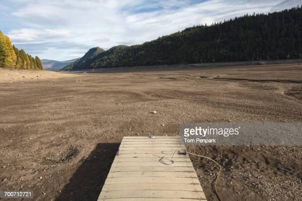 dock in dry landscape - lake bed fotografías e imágenes de stock