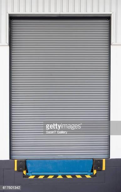 Dock leveler and shutter door