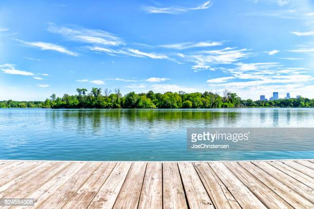 dock on lake in the city of lakes - minneapolis - lago imagens e fotografias de stock