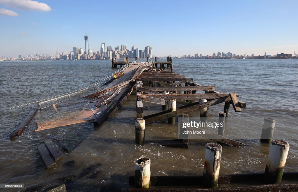A dock sits damaged near the Statue of Liberty which, remains closed to the public six weeks after Hurricane Sandy on December 13, 2012 in New York City. The storm caused extensive damage to National Park Service facilities on Liberty Island, although the statue itself remained unscathed.