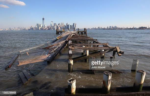 Dock sits damaged near the Statue of Liberty which, remains closed to the public six weeks after Hurricane Sandy on December 13, 2012 in New York...