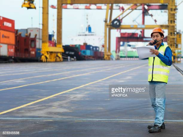 Dock worker at commercial container port in Malaysia