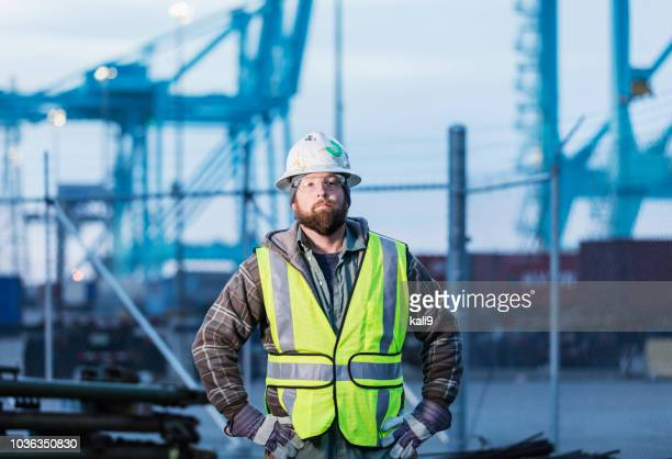 dock worker at shipping port - toughness stock pictures, royalty-free photos & images