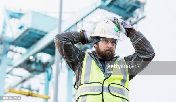 dock worker at shipping port - longshoremen stock pictures, royalty-free photos & images