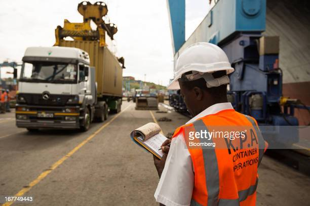 A dock worker for the Kenya Ports Authority a staterun company monitors and records the movement of shipping containers unloaded from freight ships...