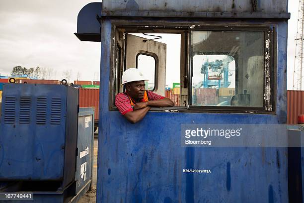 A dock worker waits for shipping containers to be unloaded from a freight ship at Mombasa port managed by the Kenya Ports Authority astaterun company...