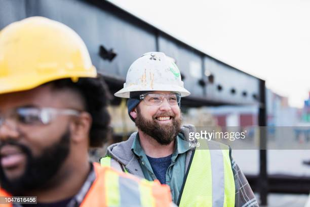 dock workers at shipping port - construction worker stock pictures, royalty-free photos & images