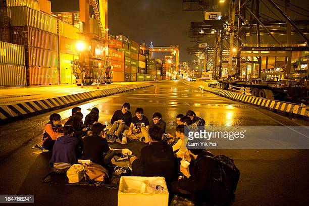 Dock workers stage a sitin as they go on strike over pay at the Kwai Chung Container Terminal on March 28 2013 in Hong Kong China The workers who are...