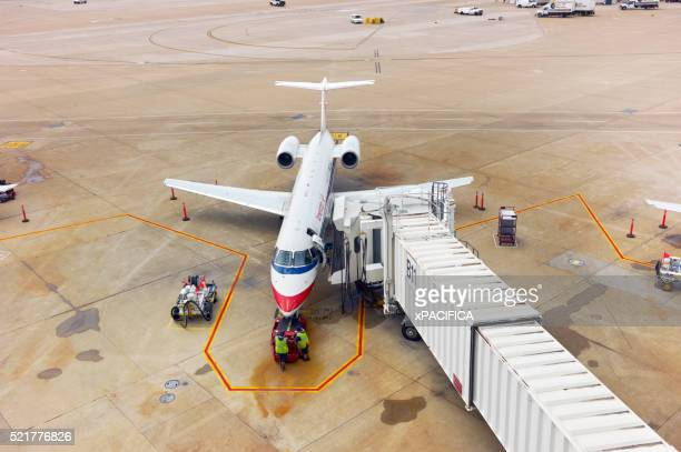 a docked american airlines plane parked on the tarmac - american airlines stock pictures, royalty-free photos & images