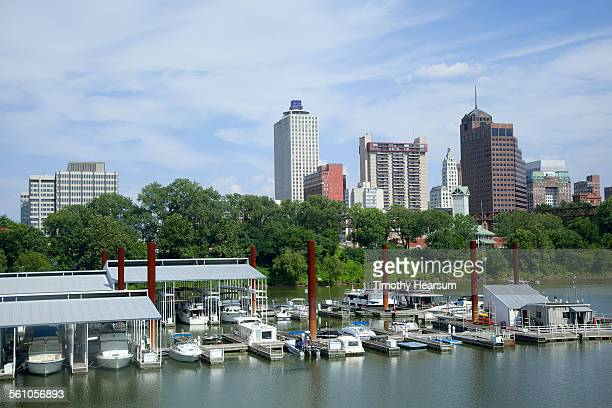 docked pleasure boats; skyscrapers/city beyond - timothy hearsum stock pictures, royalty-free photos & images