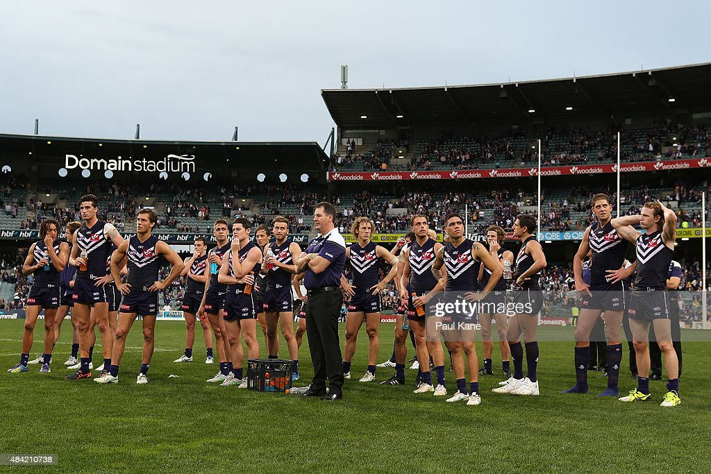 Dockers coach Ross Lyon looks on with his players after being defeated during the round 20 AFL match between the Fremantle Dockers and the West Coast Eagles at Domain Stadium on August 16, 2015 in Perth, Australia.