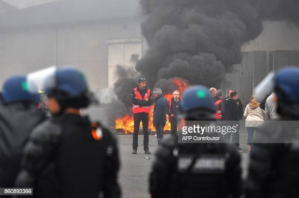 Dockers demonstrating against the labour law reform and the ecologic transition face French gendarmes on the sidelines of the inauguration of the...