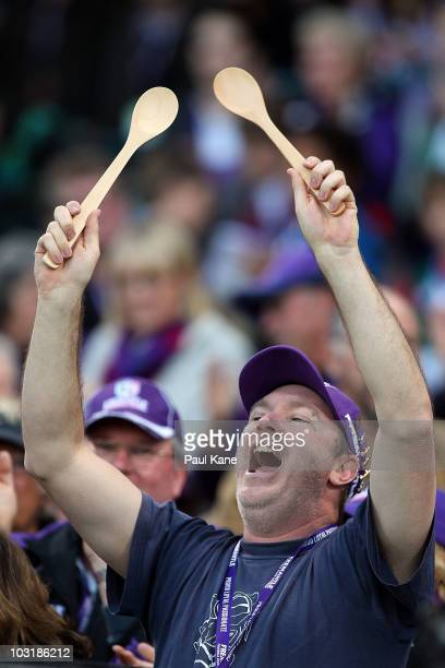 Dockers fan holds up wooden spoons during the round 18 AFL match between the Fremantle Dockers and the West Coast Eagles at Subiaco Oval on August 1...