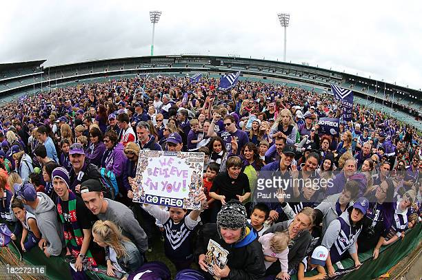 Dockers fans show their support before the team is introduced during the Fremantle Dockers Fan Day at Patersons Stadium on September 29, 2013 in...