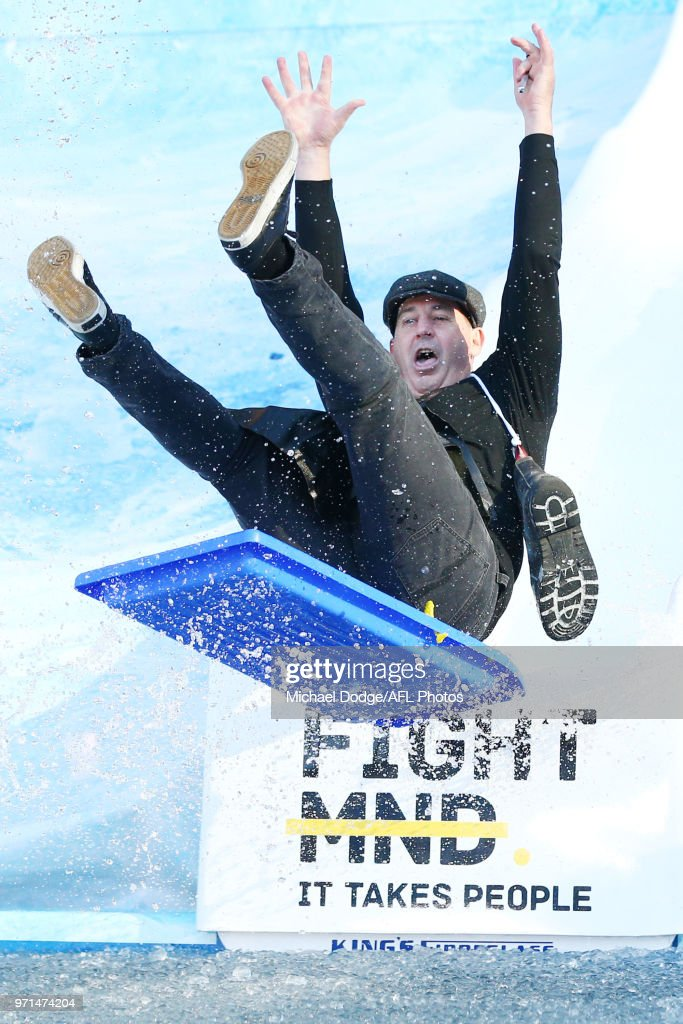Dockers head coach Ross Lyon reacts while going down the MND slide during the round 12 AFL match between the Melbourne Demons and the Collingwood Magpies at Melbourne Cricket Ground on June 11, 2018 in Melbourne, Australia.