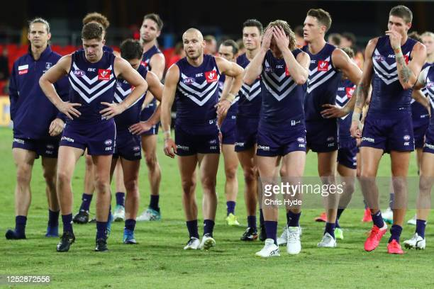 Dockers leave the field after losing the round 4 AFL match between the Gold Coast Suns and Fremantle Dockers at Metricon Stadium on June 27, 2020 in...
