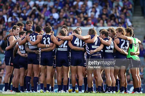 Dockers players huddle before the first bounce during the round one AFL match between the Fremantle Dockers and the Port Adelaide Power at Domain...