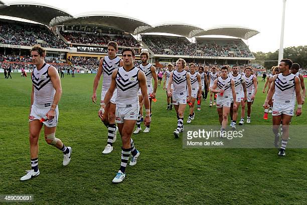 Dockers players leave the field lead by their captain Matthew Pavlich after the round eight AFL match between the Port Adelaide Power and Fremantle...