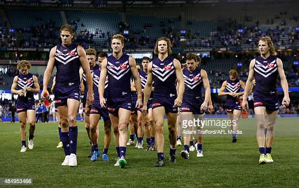 Dockers players looks dejected after a loss during the 2015 AFL round 21 match between the North Melbourne Kangaroos and the Fremantle Dockers at...
