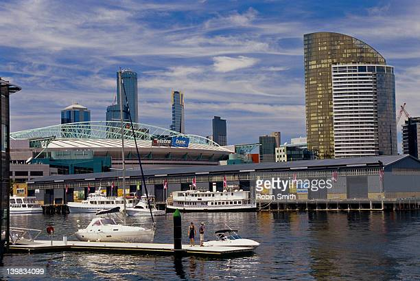 docklands complex, telstra dome, and city, melbourne, victoria, australia - docklands stadium melbourne stock pictures, royalty-free photos & images