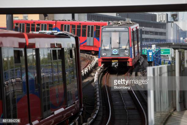 A Docklands Light Railway train approaches Poplar station in London UK on Monday Aug 14 2017 The Docklands Light Railway a lowcapacity rail system...