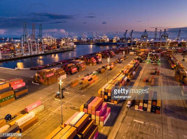 dockside container terminal in the port of long beach at twilight - aerial - port of los angeles stock pictures, royalty-free photos & images