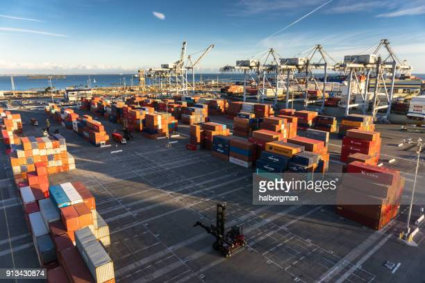 dockside container yard with ship - day - commercial dock stock pictures, royalty-free photos & images