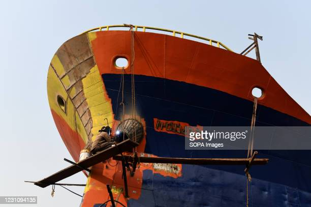 Dockyard labourer works on a boat along the banks of the Buriganga river in Dhaka. The shipbuilding industry in Bangladesh is spreading rapidly where...