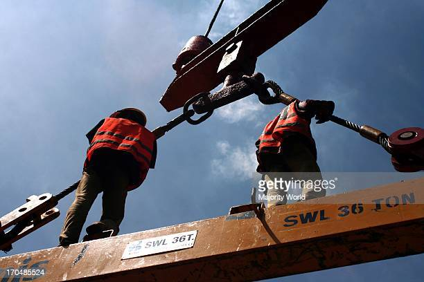 Dockyard workers working at Chittagong sea port Situated on the right bank of the Karnafuli river about 9 nautical miles from the shoreline of the...