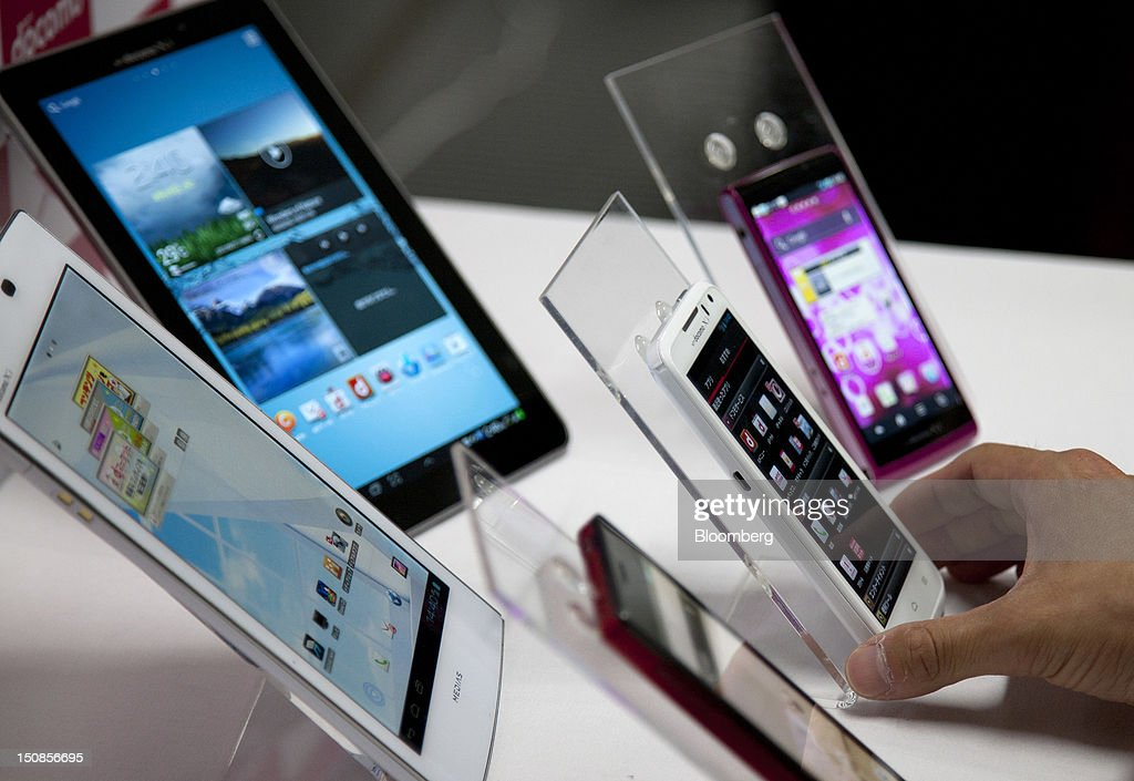 NTT DoCoMo Inc. tablet computers and smartphones are displayed during a product launch in Tokyo, Japan, on Tuesday, Aug. 28, 2012. NTT DoCoMo Inc., Japan's biggest mobile-phone company, released their latest tablet and smartphone series today. Photographer: Tomohiro Ohsumi/Bloomberg via Getty Images