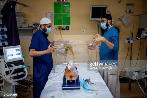 Doctor Abdullah Laher and Doctor Muhammed Moolla demonstrate how to use an intubox for worker safety designed at the Charlotte Maxeke Hospital in...