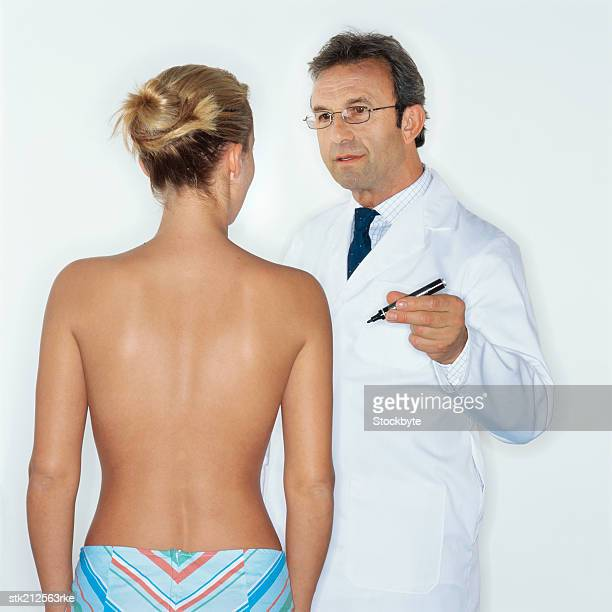 doctor advising a woman about breast surgery