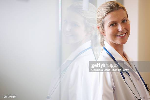 Doctor against a window, smiling