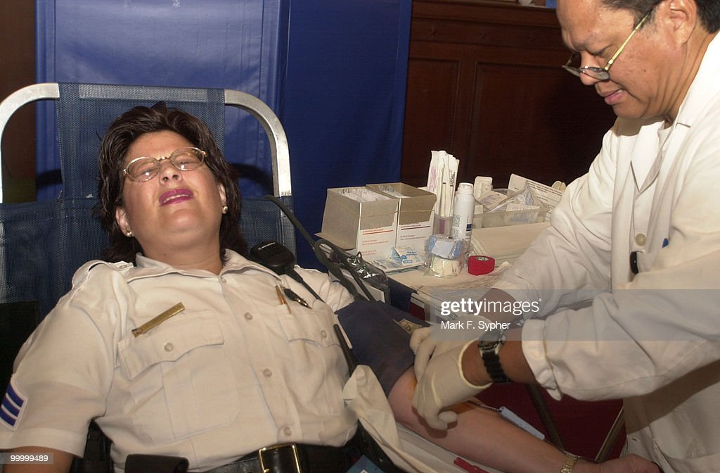 Doctor Agustin Figer Jr. shows Sgt. Rose Cabezas that giving a little blood really isn't that bad. Although Sgt. Cabezas is a rookie blood donor, she has served 23 years on the U.S. Capitol Police Force.