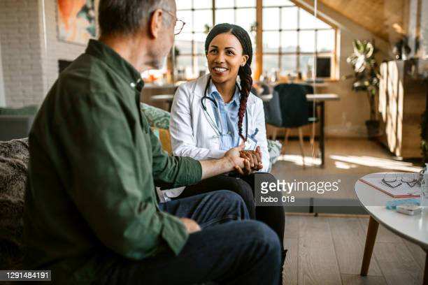 doctor and a friend - hospice stock pictures, royalty-free photos & images