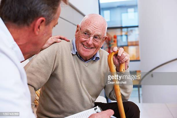 doctor and an elderly patient - fragility stock pictures, royalty-free photos & images