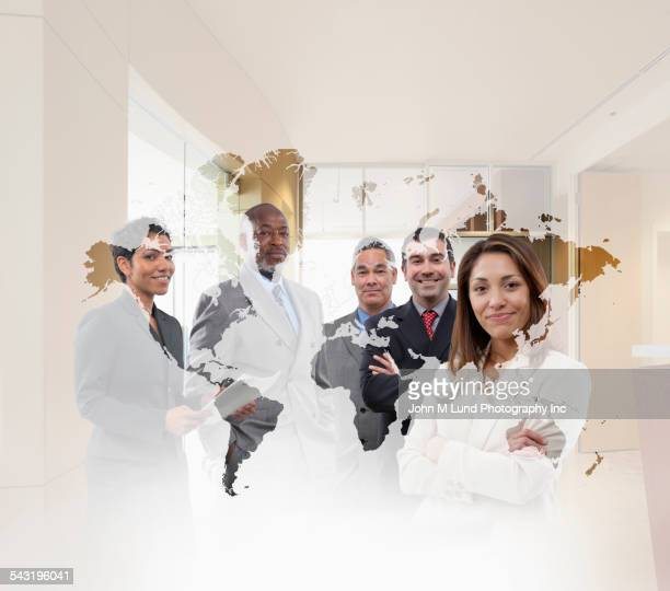 Doctor and business people standing behind world map in office
