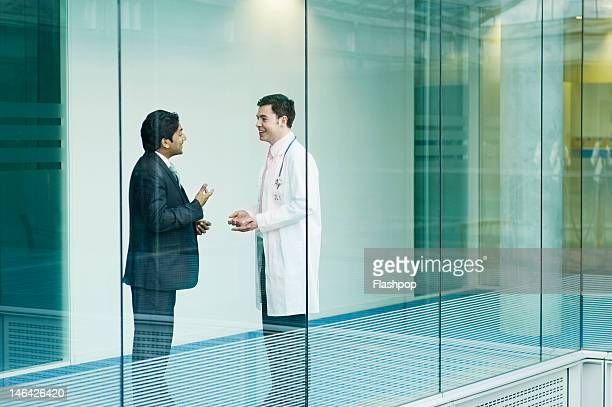 Doctor and businessman in discussion