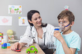 Doctor and kid on pediatrician clinic