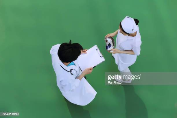 Doctor and nurse discussing medical chart