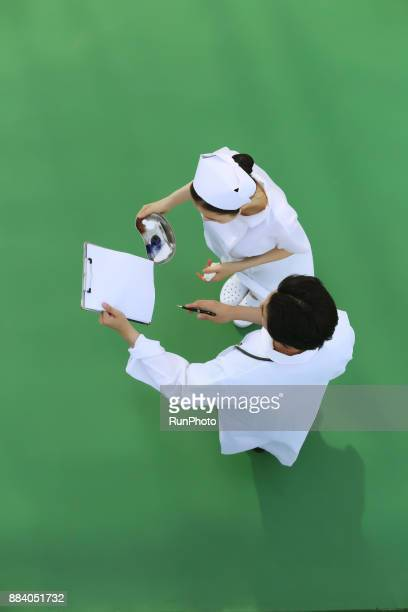 Doctor and nurse discussing patient chart