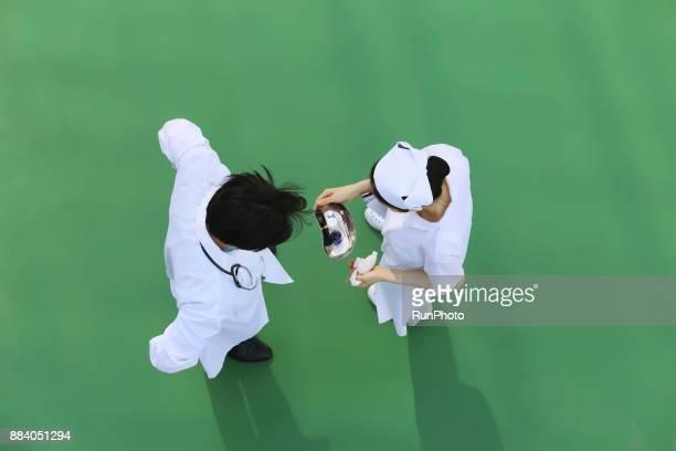 Doctor and nurse discussing prescription medicine