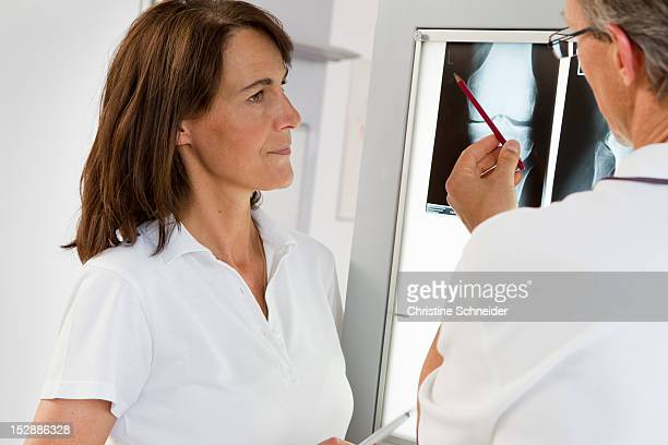 Doctor and nurse examining x-rays