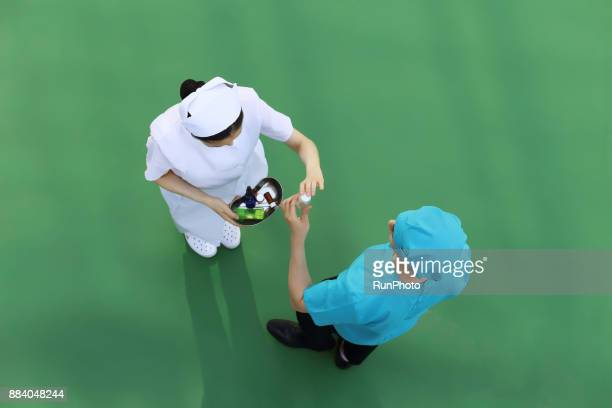 Doctor and nurse holding medicine