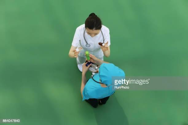 Doctor and nurse holding prescription medicine