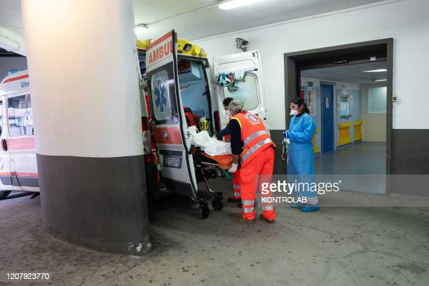Doctor and nurse prepare to unload a patient from an ambulance for the first Coronavirus checks , before entering the Emergency Room.
