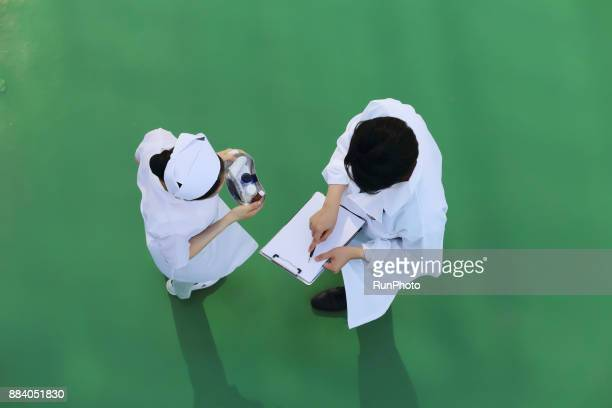 Doctor and nurse reading medical chart