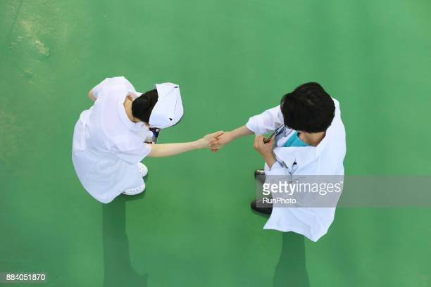 Doctor and nurse shaking hands